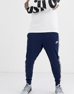 Темно-синие джоггеры с кромкой манжетом Nike Tribute-Темно-синий