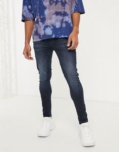 Черно-синие эластичные джинсы с напылением ASOS DESIGN-Синий