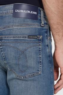 Голубые джинсы с потертостями Calvin Klein