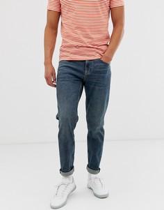 Суженные книзу темно-синие джинсы стретч в винтажном стиле ASOS DESIGN-Синий