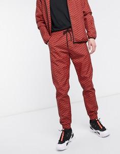 Красные спортивные штаны с узором Criminal Damage-Красный