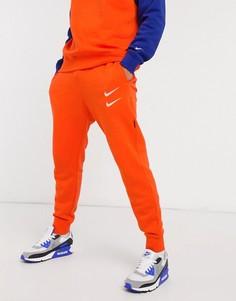 Оранжевые джоггеры с кромкой манжетом и логотипом-галочкой Nike-Оранжевый