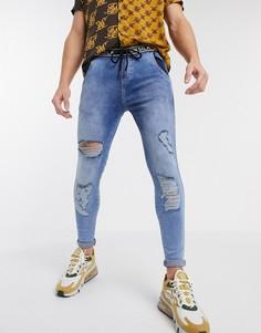 Синие джинсы скинни с эффектом кислотной стирки и логотипом SikSilk-Синий