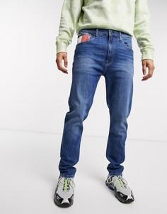Темные зауженные джинсы Tommy Jeans-Синий