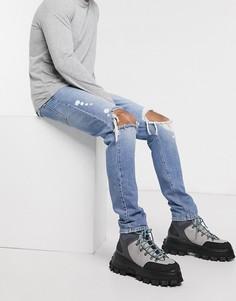 Синие джинсы заниженного кроя с рваной отделкой ASOS DESIGN-Синий