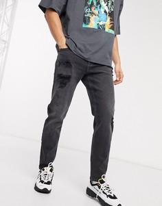 Суженные книзу черные джинсы с рваной отделкой ASOS DESIGN-Черный
