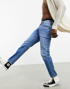 Темно-синие выбеленные суженные книзу джинсы из коллекции ответственной моды ASOS DESIGN-Синий