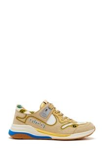 Золотистые кроссовки Gucci