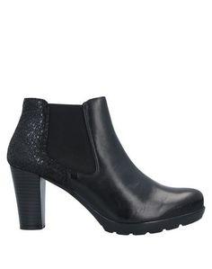 Полусапоги и высокие ботинки Raquel Perez®