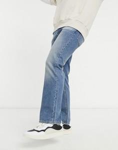 Синие выбеленные джинсы с легким клешем ASOS DESIGN-Голубой