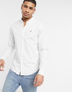 Белая оксфордская рубашка зауженного кроя на пуговицах слоготипом и длинными рукавами Hollister-Белый