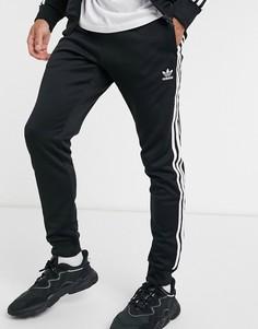 Черные джоггеры скинни с тремя полосками adidas Originals adicolor-Черный цвет