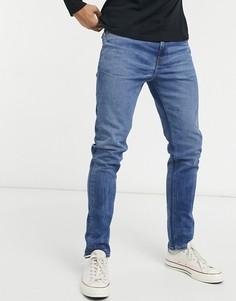 Темно-голубые облегающие джинсы с эффектом потертости ASOS DESIGN-Синий