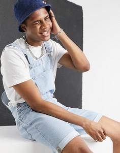 Светло-синий выбеленный джинсовый комбинезон с шортами свободного кроя ASOS DESIGN-Голубой