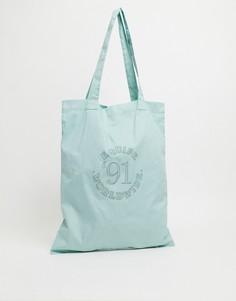 Пастельно-зеленая сумка-тоут с принтом вуниверситетском стиле ASOS DESIGN-Зеленый цвет