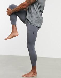 Серые спортивные леггинсы Nike Yoga-Серый