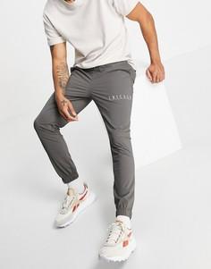 Зауженные брюки до щиколотки с принтом-названием города ASOS DESIGN-Серый
