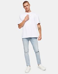 Эластичные зауженные джинсы светло-голубого выбеленного цвета из смесового органического хлопка со рваной отделкой на коленях Topman-Голубой