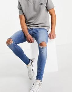 Эластичные супероблегающие джинсы выбеленного оттенка с разрывами на коленях ASOS DESIGN-Голубой